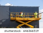 workers on the aerial work... | Shutterstock . vector #646366519