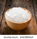 rock sugar in wooden bowl | Shutterstock . vector #646388464