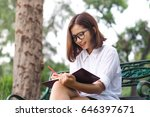 beautiful young woman studying... | Shutterstock . vector #646397671