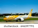 Small photo of Bangkok,Thailand - September 28, 2016 : Scoot aircraft type Boeing 787-8 (registration 9V-OFG) as seen taxiing into the parking area at Don Mueang International Airport.