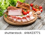 slices of bacon on the wooden... | Shutterstock . vector #646423771