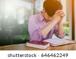 man praying on holy bible in... | Shutterstock . vector #646462249