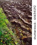 Small photo of Newly ploughed field close up - autumny agriculture work.