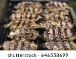 steaks on barbecue grill | Shutterstock . vector #646558699