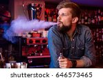 vape. vaping man in a cloud of... | Shutterstock . vector #646573465