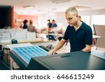 young man working in printing... | Shutterstock . vector #646615249