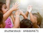 children raise hands and...   Shutterstock . vector #646664671