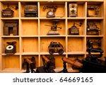 wooden shelf full of antiques... | Shutterstock . vector #64669165