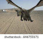 Grey Dragon Flying Over Desert...
