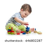 smiling baby boy playing with... | Shutterstock . vector #646802287