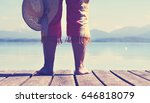 woman with hat on wooden jetty... | Shutterstock . vector #646818079