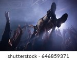 crowd surfing at a concert in... | Shutterstock . vector #646859371