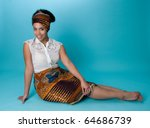 Young African American woman wearing head wrap and skirt - stock photo