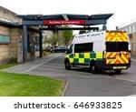 an ambulance drives into an... | Shutterstock . vector #646933825