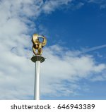 statue of men against the blue... | Shutterstock . vector #646943389