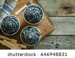 black ice cream in white cups | Shutterstock . vector #646948831