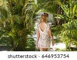 Girl Walking Through Tropical...