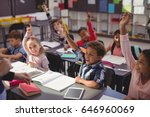 schoolkids raising their hands... | Shutterstock . vector #646960069