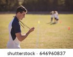 coach holding stopwatch in park ... | Shutterstock . vector #646960837