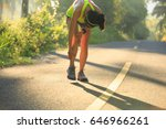 Small photo of Young female runner got sports injury on knee