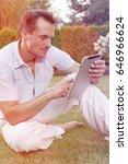 young man using digital tablet... | Shutterstock . vector #646966624