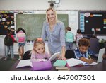 teacher helping schoolkids with ... | Shutterstock . vector #647007301