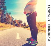fit pregnant woman standing