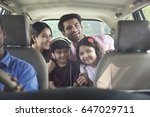 happy family in car for road... | Shutterstock . vector #647029711