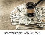wooden gavel with usa dollar on desk. close up. toned image