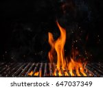 Empty Flaming Charcoal Grill...