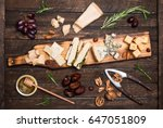 cheese platter with different... | Shutterstock . vector #647051809