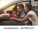 family looking at map while on... | Shutterstock . vector #647081527