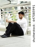Small photo of Businessman sitting Stress alone or alone strain.