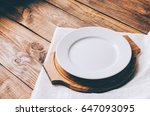 empty white plate on home... | Shutterstock . vector #647093095