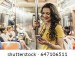 beautiful woman using phone in... | Shutterstock . vector #647106511