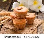 vanila cup cake  on wooden...   Shutterstock . vector #647106529