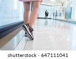 woman walking in department... | Shutterstock . vector #647111041