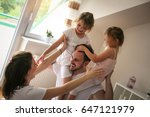 cheerful family playing...   Shutterstock . vector #647121979