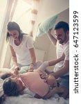 family having funny pillow... | Shutterstock . vector #647123599