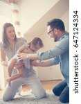 happy family sitting  on floor... | Shutterstock . vector #647124334