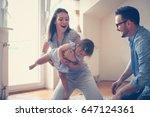 happy family sitting  on floor...   Shutterstock . vector #647124361