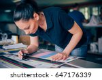 worker in a printing and press... | Shutterstock . vector #647176339
