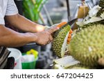 a man with knife is peeling the ... | Shutterstock . vector #647204425