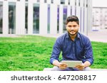 indian male student with tablet ... | Shutterstock . vector #647208817