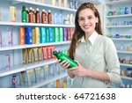 happy woman at pharmacy buying shampoo - stock photo