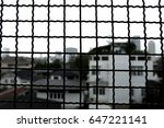city view on steel grille | Shutterstock . vector #647221141