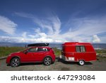 red car with tiny camper... | Shutterstock . vector #647293084