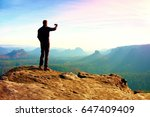 slim tourist on the cliff of... | Shutterstock . vector #647409409
