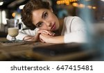 young woman in the cafe.... | Shutterstock . vector #647415481