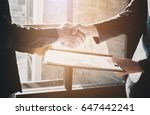 young businessmen collaborate... | Shutterstock . vector #647442241
